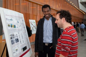Tagbo Niepa, REACT Fellow, shares his poster with Remi Dreyfus from Solvay and CNRS.