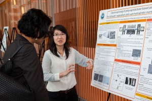 Corning Inc. Scientist, Wageesha Senarante, learns about new techniques developed in the Yang lab.