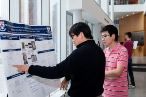 Penn Polymer researchers discuss polymerization reaction development.