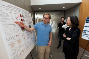 Ted Trigg, REACT Fellow, discusses his poster with REACT Education Director, Kristin Field.