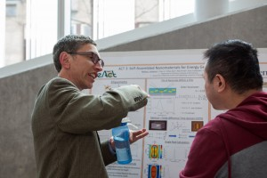 Russ Composto, REACT Faculty, discuses research with PhD student Chen Li.