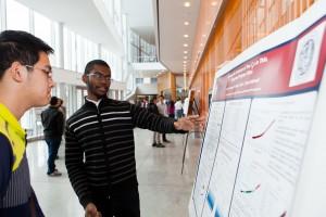 Gabriel Angrand, REACT undergraduate, explains his poster.